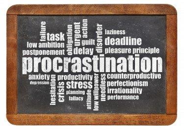 procrastination word cloud on a vintage blackboard isolated on white