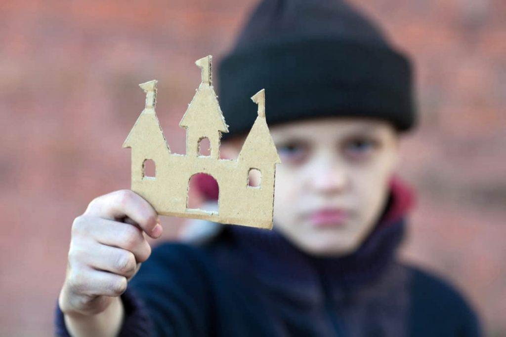 lesson, teacher, thankful, thanks, yong homeless boy holds a cardboard castle, dirty hand, dream concept, portrait